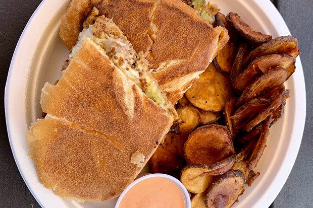 Shred Town Cuban sandwich with a side of spuds. - JOSHUA SAVAGE
