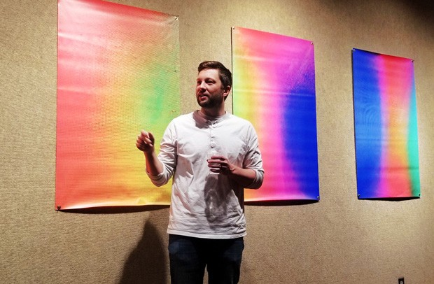 Artist Kiel Fletcher discussing his work, exhibiting now at Pence Pinckney Gallery on the COCC campus. - CARI BROWN