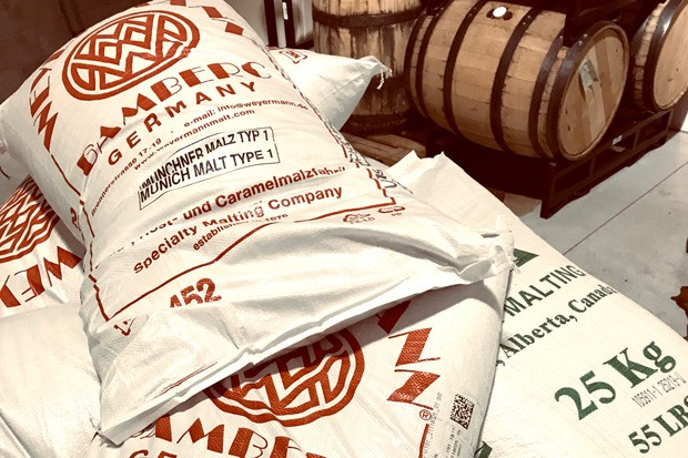 Bags of malted barley ready to be made into delicious beer. - ZACH BECKWITH