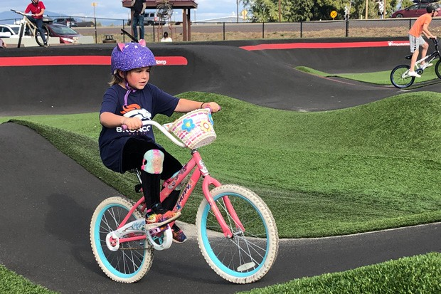Miles, a first grader who sports a coaster-brake bike, said she liked how Homestead's pump track helped her practice her bike skills. - NICOLE VULCAN