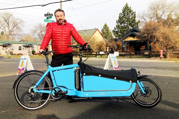 Stewart Fritchman, owner of Bellatazza Coffee, stands with the cargo bike he recently bought at Bend Electric Bikes to deliver coffee orders to his customers. - COURTNEY VAN FOSSAN