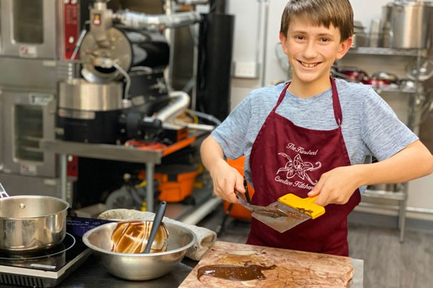 Reggie Strom tempers chocolate to make curls at Kindred Creative Kitchen. - LISA SIPE
