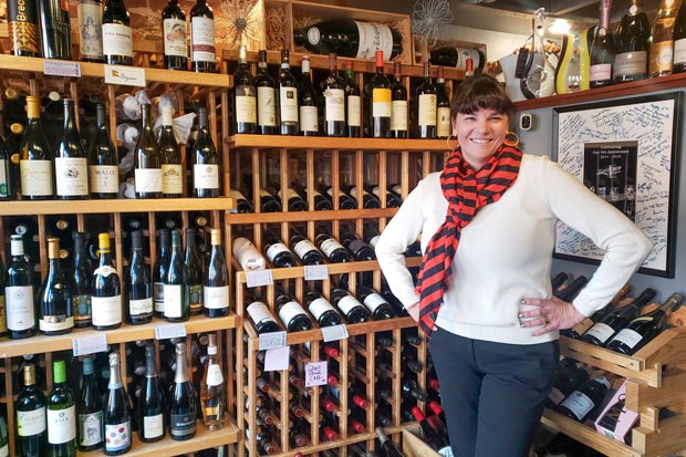 Sarah Worley stands amidst her hand-picked collection of regionally and internationally renowned wines. - CAYLA CLARK
