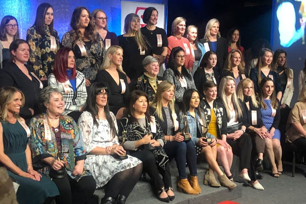 What a crew! Some of the dozens of nominees pose for the camera during the Women of the Year awards at Eagle Mountain Event Center Feb. 28. - NICOLE VULCAN