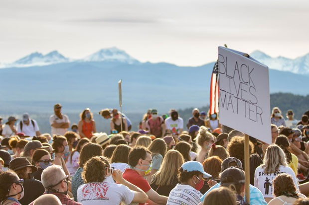 Hundreds gather for the Take Back The Butte march on June 19, which took place on Pilot Bute, the site of KKK cross burnings in the early 20th Century. - KYLE SWITZER