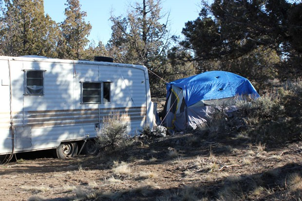 The dirt road leading out of Juniper Ridge was still open this weekend, allowing people to transport the last of their personal belongings off the property. - LAUREL BRAUNS