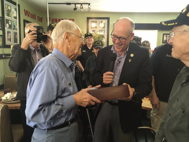 Greg Walden presents Bob Maxwell with American flag flown over U.S. Capitol to honor Maxwell's 97th birthday in 2017 in Bend. - COURTESY REP. GREG WALDEN