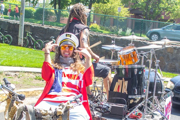 "No live music?! Make your own live music! A local drummer and his trusty bike ""captain"" entertain people in the street at the start of Bend's Freedom Ride on July 4, before riding off into the sunset on Wall Street. Due to COVID-19, the Bend tradition of riding bikes though downtown on July 4 was only about 1/4 of the usual size. - KYLE SWITZER"