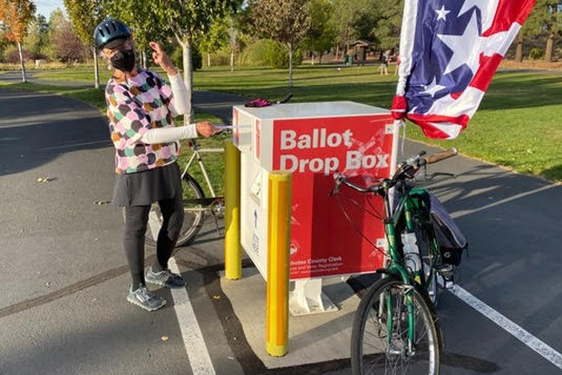 Floy Sitts places her ballot into the official box at Pine Nursery Park in Bend over the Oct. 17 weekend. All registered voters should have received their ballots by now. If yours hasn't arrived, contact the Deschutes County Clerk. - RICHARD SITTS