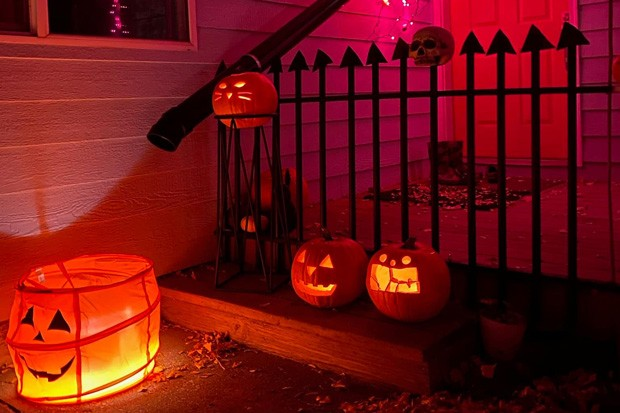Headstones crafted from cardboard invite the neighborhood kids to go through on Halloween night—if they dare. - MIKE MANSER