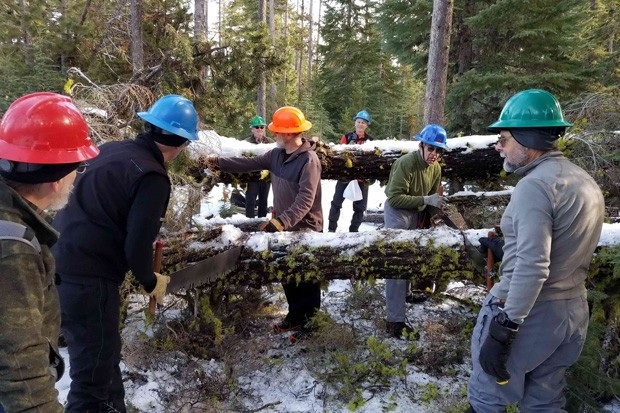 A team of volunteers works on clearing snowshoe trails. - CENTRAL OREGON NORDIC CLUB