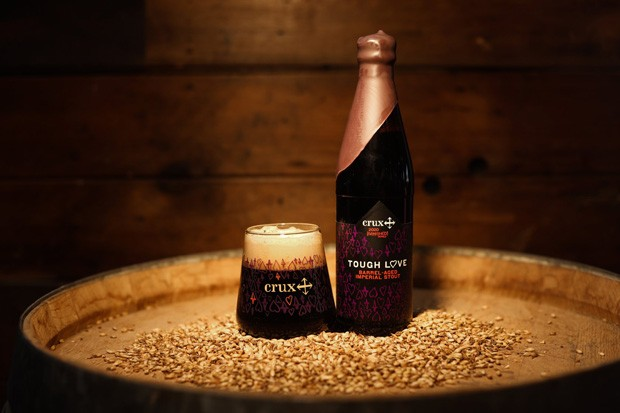 Tough Love 2020, along with its new commemorative glass. - COURTESY CRUX FERMENTATION PROJECT/FACEBOOK