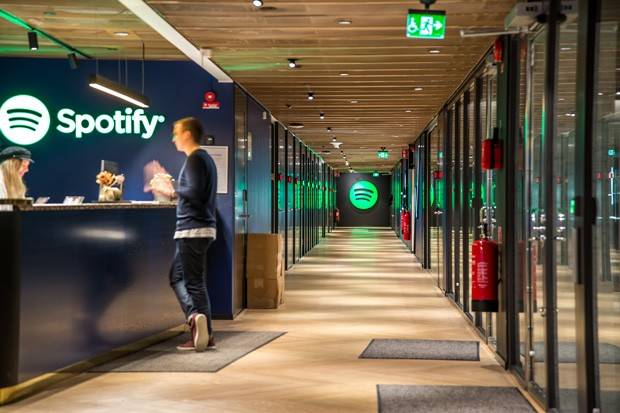 Is Spotify's logo green because they love money? We don't know. But that wouldn't be hard to believe at this point. - COURTESY SPOTIFY