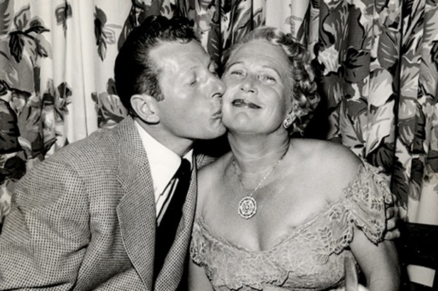 Actor Danny Kaye and friend Jennie Grossinger keep it real (and interesting) with this peck on the cheek, circa 1951. - COURTESY LIBRARY OF CONGRESS