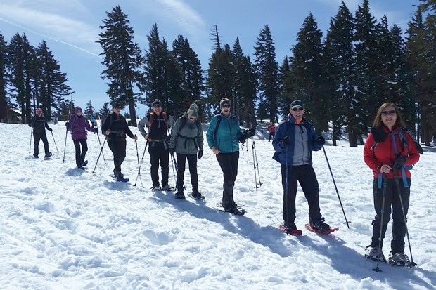 Skiers and snowshoers explore the winter wonderland in Crater Lake National Park. - DAMIAN FAGAN