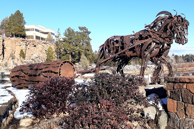Bend's ironwork sculptures, including this one in Riverbend Park, are an homage to the city's lumber-mill history. - DAMIAN FAGAN