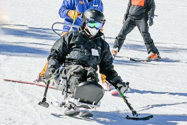 OAS tethering a sit skier. - COURTESY OREGON ADAPTIVE SPORTS