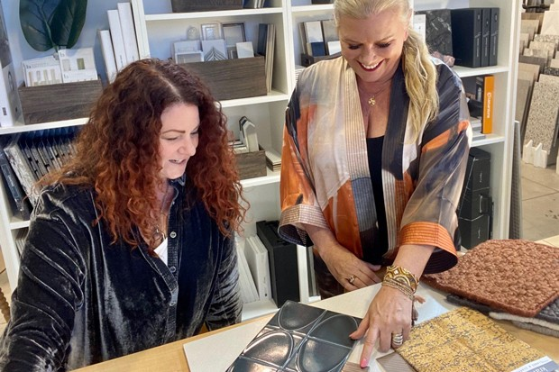 Co-owners and founders Kerri Rossi and Jane Wirth pick out the latest in design trends from their new Element Design Collective showroom; laying out surface textures in the Elemental Design Collective showroom helps clients visualize their remodels and new builds. - COURTESY KERRI ROSSI