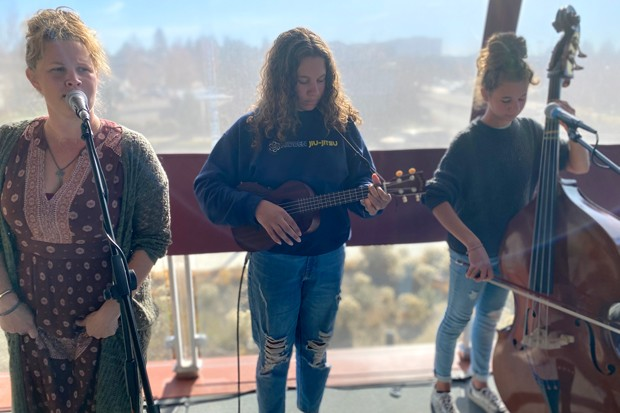 """Melodi Johnson, at left, with twins Shiloh Johnson and Abigail Johnson, at their first """"official"""" show during Bend Roots Revival in October. - NICOLE VULCAN"""