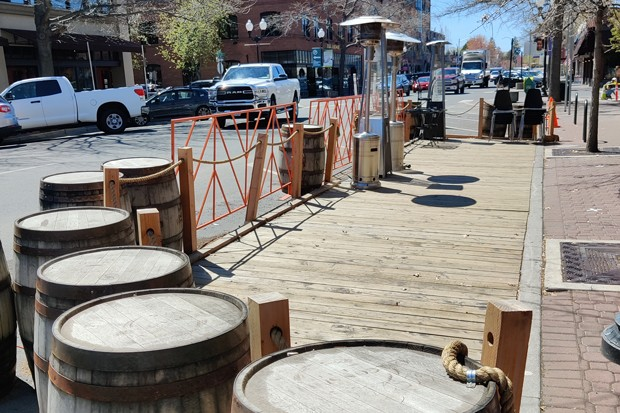 If downtown parklets like this one at Zydeco Kitchen & Cocktails prove to be a success, they could become permanent. - JACK HARVEL