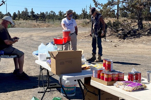 Every Friday from 10 am to noon, Redmond service providers bring resources, such as food, water and propane, to the end of East Antler Avenue, where many Redmond campers live. - COURTESY BOB BOHAC