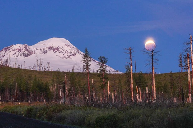 Now that's a lunar eclipse! Over South Sister! @art_of_adventures shared this photo with us of the May 26 blood moon eclipse. Tag us @sourceweekly for a chance to be featured here and in the Instagram of the Week in the Cascades Reader—plus now, get a framed print of your piece courtesy of High Desert Frameworks. - @ART_OF_ADVENTURES / INSTAGRAM