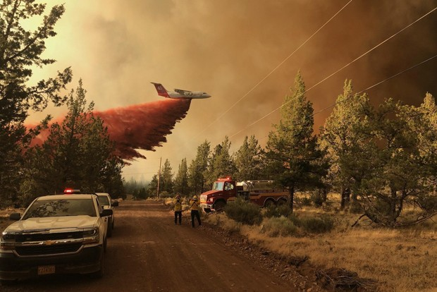 One of five large air tankers dropping retardant on the Grandview Fire on July 11. - COURTESY OF INCIWEB