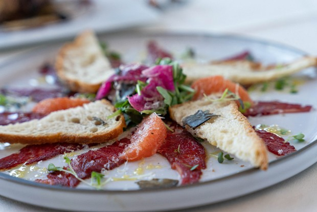 Wagyu Carpaccio featuring 2 Sisters Ranch beef. - MIKE WEST