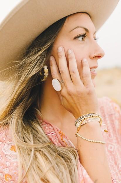 Bronwen  Cuddled Hearts Earrings by WorldScout, $98  Moonstone Ring by WorldScout, $98  Solstice Bracelet by Bronwen, $39  Peeky Bracelet by WorldScout, $39  /  Dutch + Bow  'Colorado Winter' Handmade Wool Hat by Hampui Hats, $375 - DREW CECCHINI
