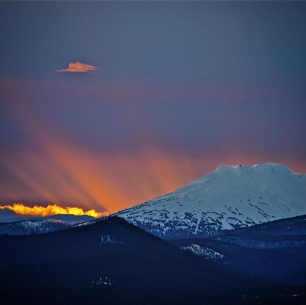 The sun sets behind Mt. Bachelor.