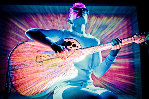 Kaki King uses projection mapping to fuse audio and video in telling the guitar's story. - SIMONE CECCHETTI