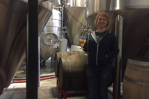 Tonya Cornett of 10 Barrel is at home among the fermenters. - KEVIN GIFFORD