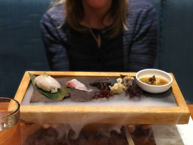 Japanese striped bass served four ways turned into theater as the dish billowed with dry ice. - LISA SIPE