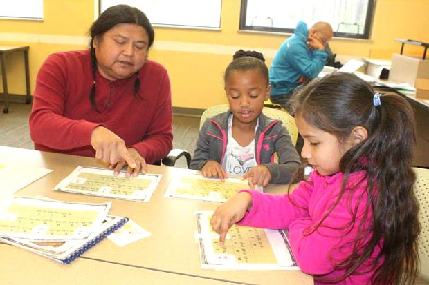 Tribal language teacher Dallas Winishut goes over the Ishishkiin (Wasco) alphabet at the Warm Springs K-8 Academy in 2017. The Academy is one of the three schools in the Jefferson County School District has a 21st Century Community Learning Centers afterschool program. - MADRAS PIONEER