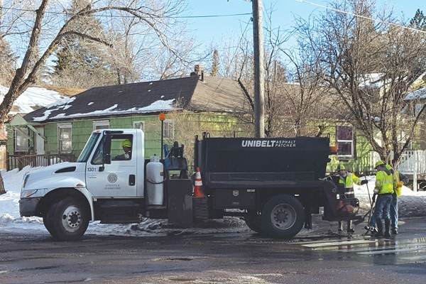 Bend street crews filling potholes. - SOURCE WEEKLY ARCHIVED PHOTO