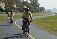 Cyclists use the greenway in the Gateway National Recreation Area.