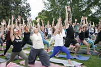 Yogis get their Warrior One on during the pre-show yoga sesh at the Art Station Tuesday.