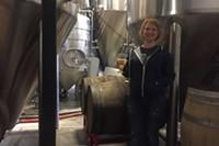Tonya Cornett of 10 Barrel is at home among the fermenters.