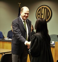 Chris Piper being sworn in to the Bend City Council on Jan. 30.