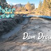 A water pipe sits in a ditch before it was buried by Central Oregon Irrigation District to replace open-air canals. Canals can lose up to half of their water in transit through seepage into the ground and evaporation, piping advocates say.