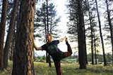 A yoga participant smiles while in a pose connected to the trees at Indian Ford Meadow Preserve. - Uploaded by DeschutesLandTrust1
