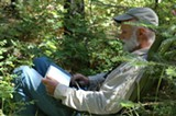 A man in a chair among the tree field sketching - Uploaded by Cara Frank