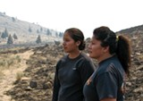 ERIN ROOK - Karlen Yallup (left) and her mother Yvette Leecy, both firefighters, look out over a singed Warm Springs.