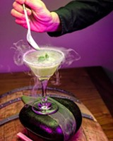 "PHOTO BY ALEXANDER IVY. FOLLOW HIM ON INSTAGRAM @ALEXANDER_IVE_LEAGUE - 5 Fusion and Sushi Bar mixologist Scotty creates a ""Frozen-Top Martini"" a drink that hovers in the realms of beauty and science."