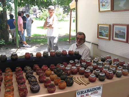 ACCESSORIES Mario Pareguetti, a mate gourd vendor in the street fair. - JAY SCHERF