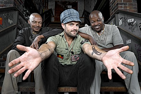 ALL HANDS Xavier Rudd, center, plays a contraption that looks like an ancient spaceship.