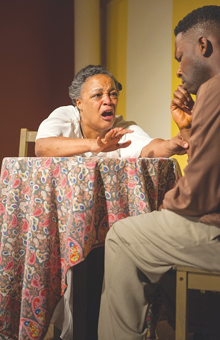 AMEN TO THAT Cathleen Riddley tries to keep Rotimi Agbabiaka from leaving the flock in 'Amen Corner.' - DAVID ALLEN