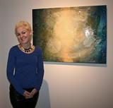 Artist Erin Parish stands proudly next to her work.