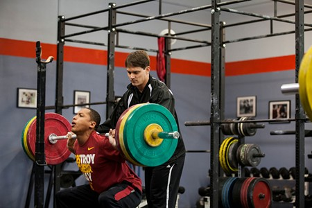 BACKBREAKER Freddie Myles assists USC decathalon athlete Jemal Williams, 19, with a lift in Petaluma.