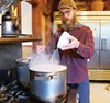 BRAUMEISTER: Anthony Musick cooks up an all-grain beer on the stovetop.
